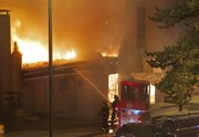 Firefighters battle a massive fire Tuesday night, Feb. 19, 2013 at JJ&#39;s restaurant at the Country Club Plaza in Kansas City, Mo. A natural gas leak fed the flames for hours.