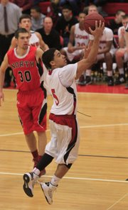 LHS's Justin Roberts (5) makes a easy two points on Tuesday, Feb. 19, 2013. LHS won, 71-53.