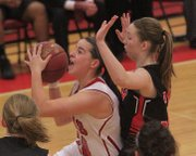 LHS senior Anna Wright (24) goes up for two points against Shawnee Mission North&#39;s Bridget Wray (31) on Tuesday, Feb. 19, 2013.
