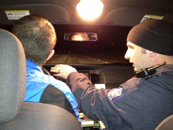 Officer Josh Guile coaches Mike Bourneuf on making a traffic stop.