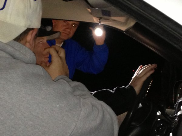 Mike Bourneuf checks out the inside of the van as the occupants give him bogus answers to his questions.