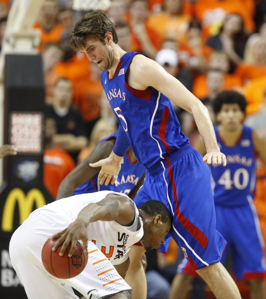 Kansas center Jeff Withey blocks a drive by Oklahoma State guard Marcus Smart during the first half on Wednesday, Feb. 20, 2013 at Gallagher-Iba Arena in Stillwater, Oklahoma.