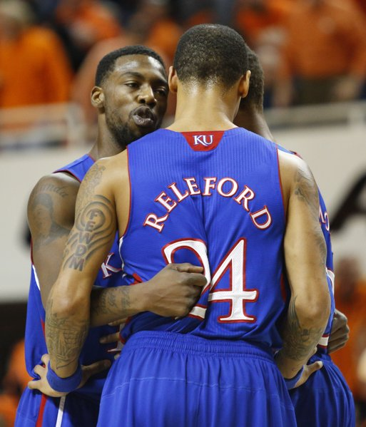 Kansas guard Elijah Johnson huddles up with teammates Travis Releford and Ben McLemore, back, during the first half on Wednesday, Feb. 20, 2013 at Gallagher-Iba Arena in Stillwater, Oklahoma.
