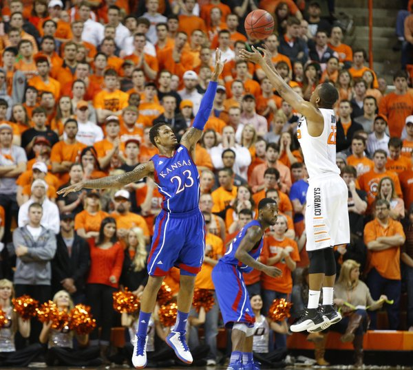 Kansas guard Ben McLemore defends against a shot from Oklahoma State guard Markel Brown during the first half on Wednesday, Feb. 20, 2013 at Gallagher-Iba Arena in Stillwater, Oklahoma.
