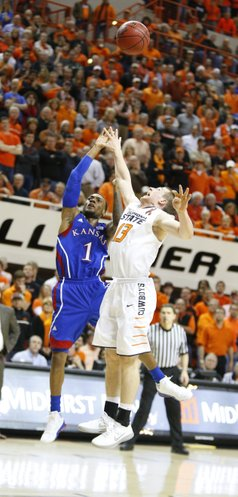 Kansas guard Naadir Tharpe puts a floater over Oklahoma State guard Phil Forte to give the Jayhawks the advantage with seconds remaining in double overtime on Wednesday, Feb. 20, 2013 at Gallagher-Iba Arena in Stillwater, Oklahoma.