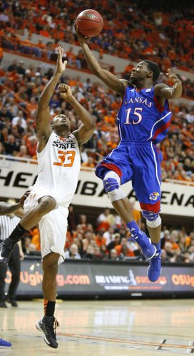 Kansas guard Elijah Johnson puts up a floater over Oklahoma State guard Marcus Smart during the second half on Wednesday, Feb. 20, 2013 at Gallagher-Iba Arena in Stillwater, Oklahoma.