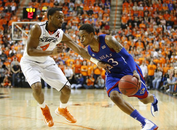 Kansas guard Ben McLemore drives against Oklahoma State guard Brian Williams during the first overtime on Wednesday, Feb. 20, 2013 at Gallagher-Iba Arena in Stillwater, Oklahoma.