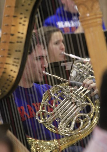 "French horn players Stephen Meiller and Muriel Hague, along with members of the Kansas University Wind Ensemble, rehearse ""In the Shadow of No Towers"" at Murphy Hall. The ensemble will travel to New York to perform the world premiere of the piece, by New York composer Mohammed Fairouz, at Carnegie Hall."