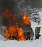 Fire crews extinguish a car fire in the 1300 block of Lawrence Avenue at about 12:10 p.m. Crews extinguished two car fires in Lawrence on Thursday afternoon, according to Lawrence-Douglas County Fire Medical shift supervisors. Another car caught fire in the 600 block of Florida St. In each case, the vehicle accidentally caught fire while struggling in today's snowstorm.