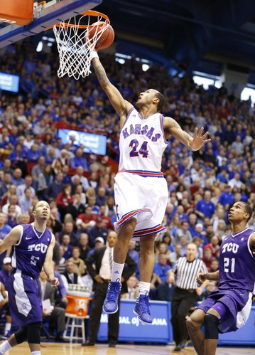 Kansas guard Travis Releford lays in a bucket on a break against Texas Christian during the first half on Saturday, Feb. 23, 2013 at Allen Fieldhouse.