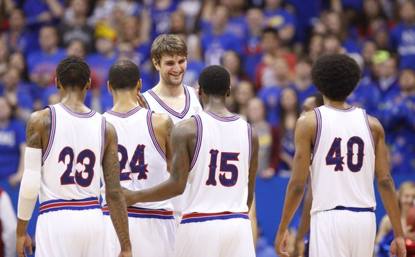 Kansas center Jeff Withey smiles with the rest of the starters during a break in action in the second half on Saturday, Feb. 23, 2013 at Allen Fieldhouse.