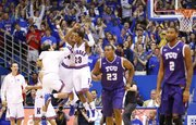 Kansas guard Ben McLemore celebrates a dunk to end the half against Texas Christian with teammates Travis Releford and Niko Roberts during the first half on Saturday, Feb. 23, 2013 at Allen Fieldhouse.