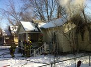 Firefighters work on a house fire Sunday morning at 1132 New York St. The fire was reported about 8:45 a.m.
