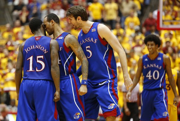 Kansas players Travis Releford and Jeff Withey (5) get up close and personal with Elijah Johnson after Johnson hit a long three in overtime against Iowa State on Monday, Feb. 25, 2013 at Hilton Coliseum in Ames, Iowa.