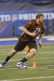 Kansas offensive lineman Tanner Hawkinson runs a drill during the NFL football scouting combine in Indianapolis, Saturday, Feb. 23, 2013.