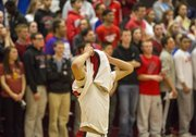 Lawrence High sophomore Anthony Bonner pulls his jersey over his head as time expires during Lawrence High's first round game against Blue Valley West in the boys 6A sub-state basketball tournament, held Wednesday night at LHS. The Lions season ended with a 60-55 loss.