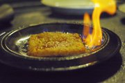 The Flaming Cheese, or Saganaki, appetizer at the Mad Greek, 907 Massachusetts St.