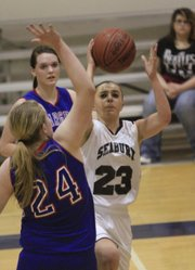 Bishop Seabury senior Alexa Gaumer (23) gets through the paint for a layup against Wabaunees&#39;s Alli Terrapin in a sub-state playoff game Wednesday, Feb. 27, 2013, at Seabury.