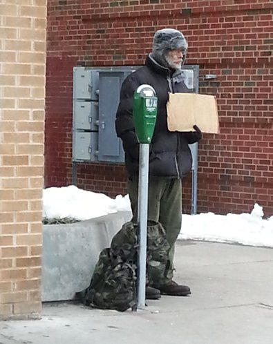 Lawrence Donation Meters provide ambiance for a panhandler.