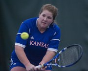 Kansas' Dylan Windom returns the ball against UMKC on Thursday, Feb. 28, 2013, at  Jayhawk Tennis Center.