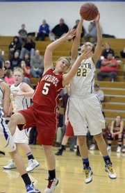 Bri Anderson (5) battles for the rebound as Lawrence's girls played Olathe South in first round sub-state action Thursday, Feb. 28, in Olathe.