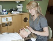 Amy Franklin, Oraspa specialist at Advanced Dental Studio of Joseph R. Gatti, DDS, PA, 5100 Bob Billings Parkway, Suite 110, applies some cooling patches over the eyes of client Patti Pilshaw, Lenexa, on Thursday. The treatment also included soothing music and aromatherapy with a scented spray of chamomile, lavender and rose. Oraspa is a natural option for sedation dentistry that can be used by anyone but is especially effective for those with anxiety about dental work.