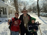 Ten-year old snow shovelers Sean Ayers and Kyle Miller with Journal-World reporter Chad Lawhorn while he was out recently helping Lawrence residents dig out from the massive winter storms.