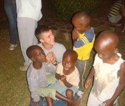 Matt Visser, now a senior at Kansas University, plays with children at an orphanage in Rwanda in summer 2011, when he was in the country on a Department of Defense internship. He helped teach English to Rwandan troops.