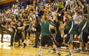 The Free State bench erupts in celebration as time expires in their sub-state regional championship game against Olathe East Friday evening in Olathe. The Firebirds advanced to the state championship tournament with a 45-44 victory.