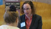 Lawrence school board candidate Kristie Adair speaks with a voter Saturday during a candidate fair at the Carnegie Building. Adair is one of four candidates vying for three seats on the school board in the April 2 general election.