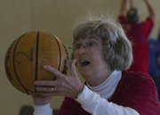 Pastor Shirley Edgerton, of the Vinland United Methodist Church, made 100 free throws Saturday at an event to raise money to fight malaria.