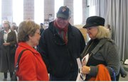 Jana Rae, right, chairwoman of the Douglas County Republican Party, and her husband Edmond, center, talk about city and school board issues with voters Saturday during a candidate fair sponsored by the Voter Education Coalition. Voters will elect three school board members and three city commissioners April 2, as well as decide on a proposed $92.5 million school bond issue.