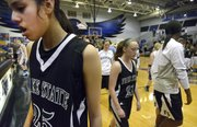 Millie Shade (25), Ariana Frantz (21) and the rest of the Free State girls walk away after a 68-31 loss to Olathe Northwest on Saturday, March 2, 2013, in Olathe.