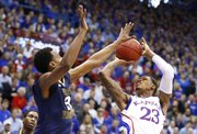 Kansas guard Ben McLemore is fouled by West Virginia guard Matt Humphrey during the first half on Saturday, March 2, 2013 at Allen Fieldhouse.