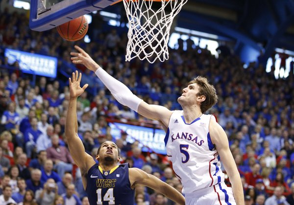 Kansas center Jeff Withey blocks a shot by West Virginia guard Gary Browne during the second half on Saturday, March 2, 2013 at Allen Fieldhouse.