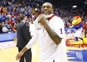 Kansas guard Naadir Tharpe smiles after some words from head coach Bill Self following the Jayhawks' 91-65 win over West Virginia on Saturday, March 2, 2013 at Allen Fieldhouse.
