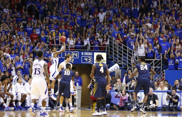 Kansas guard Ben McLemore puts up a three in the corner against West Virginia during the second half on Saturday, March 2, 2013 at Allen Fieldhouse.