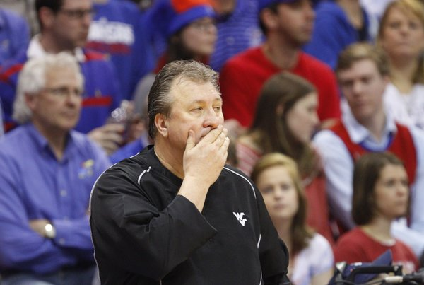 West Virginia head coach Bob Huggins rubs his mouth during a Jayhawk run on Saturday, March 2, 2013 at Allen Fieldhouse.