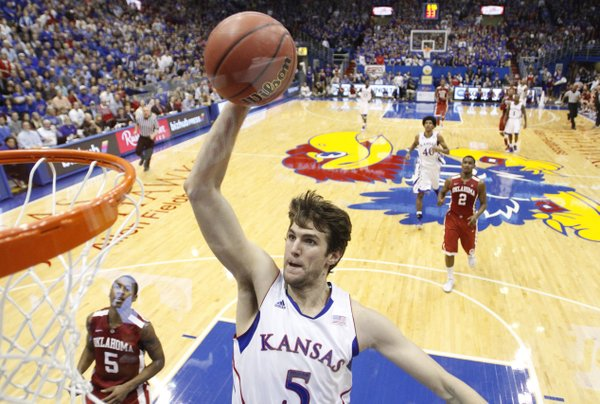 Kansas center Jeff Withey comes in for a jam against Oklahoma Jan. 26 at Allen Fieldhouse. This photo was taken using a remote camera with a wide-angle lens placed behind the glass of the backboard.
