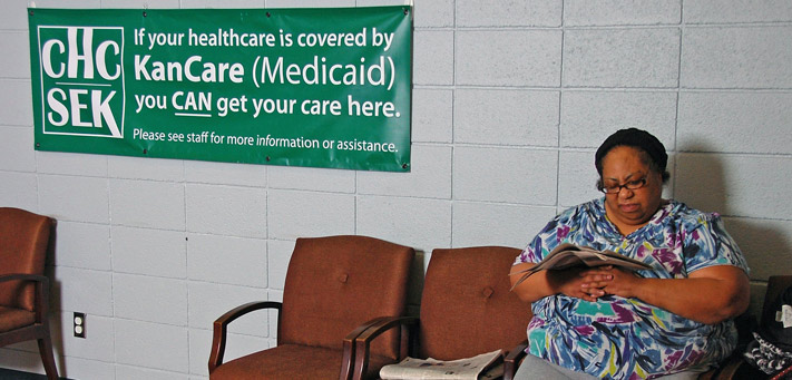 Charlene Robinson waits for her appointment at the Community Health Center of Southeast Kansas clinic in Coffeyville. To help alleviate patient confusion regarding their healthcare providers through the new KanCare program, CHC/SEK clinics have posted banners to inform patients that they may receive their healthcare services through CHC/SEK.