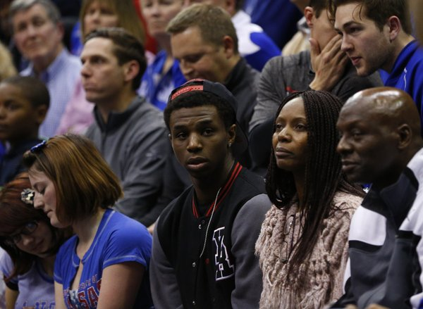 Kansas recruit Andrew Wiggins watches from behind the bench during the second half, Monday, March 4, 201