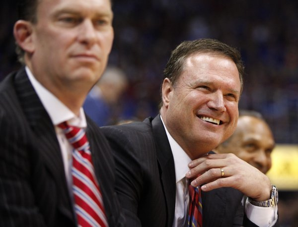 Kansas head coach Bill Self laugh during the senior speeches, Monday, March 4, 2013 at Allen Fieldhouse.