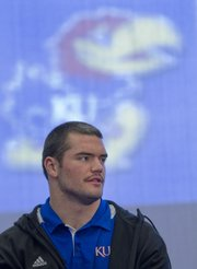 Linebacker Ben Heeney, speaks to reporters during a spring football practice press conference Monday, March, 4, 2013 at KU.
