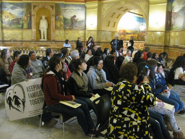 Members of Sunflower Community Action assembled Wednesday in the Statehouse to urge rejection of two bills that they said would hurt immigrants.