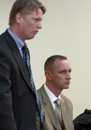 Franklin County Sheriff Jeff Curry, right, appears with his attorney, Trey Pettlon, Wednesday in Franklin County District Court. Curry, along with Franklin County Sheriff's Office Deputy Jerrod Fredricks, are charged with a felony count of interfering with law enforcement. A preliminary hearing on the case was scheduled for April 1.