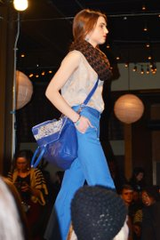 Blue high-waisted trouser pants/blue leather crossbody bag from designer Emma Lammers at Kansas City Fashion Week on Feb. 28, 2013.
