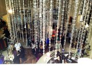 Photo taken from the loft of Garment District Boutique during the kick-off party showcasing the chandelier in the boutique during Kansas City Fashion Week on Feb. 28, 2013.