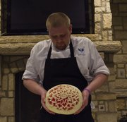 Sous Chef Mike Davis shows off a carved watermelon.