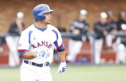 Kansas batter Ka'iana Eldredge watches his second-inning triple land in the outfield against Niagara on Friday, March 8, 2013 at Hoglund Ballpark. The shot drove in the Jayhawks' second run of the game.