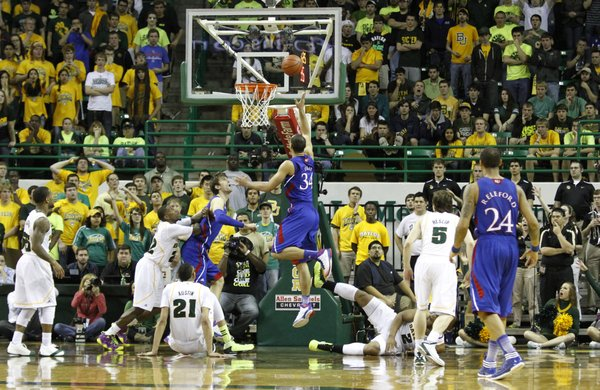 Perry Ellis (34) splits defenders for a layup in KU&#39;s 81-58 loss to the Baylor Bears Saturday in Waco.